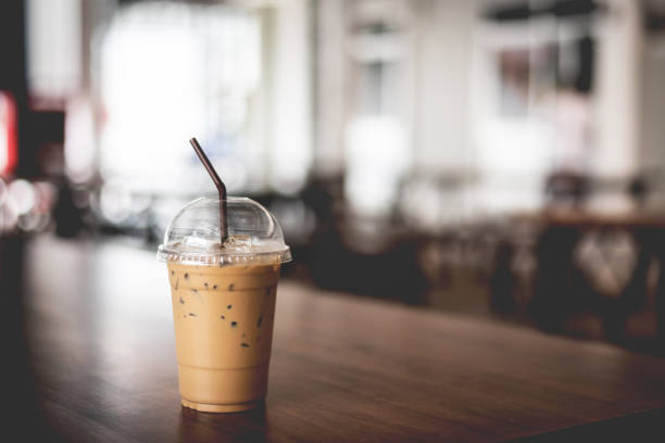 Iced espresso on the wooden table with nature light background stock photo