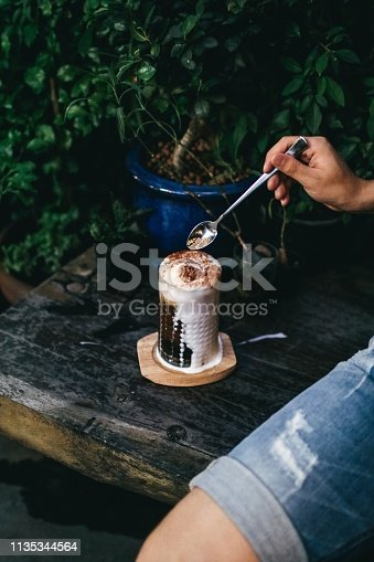 Iced Espresso vanilla float with spoon