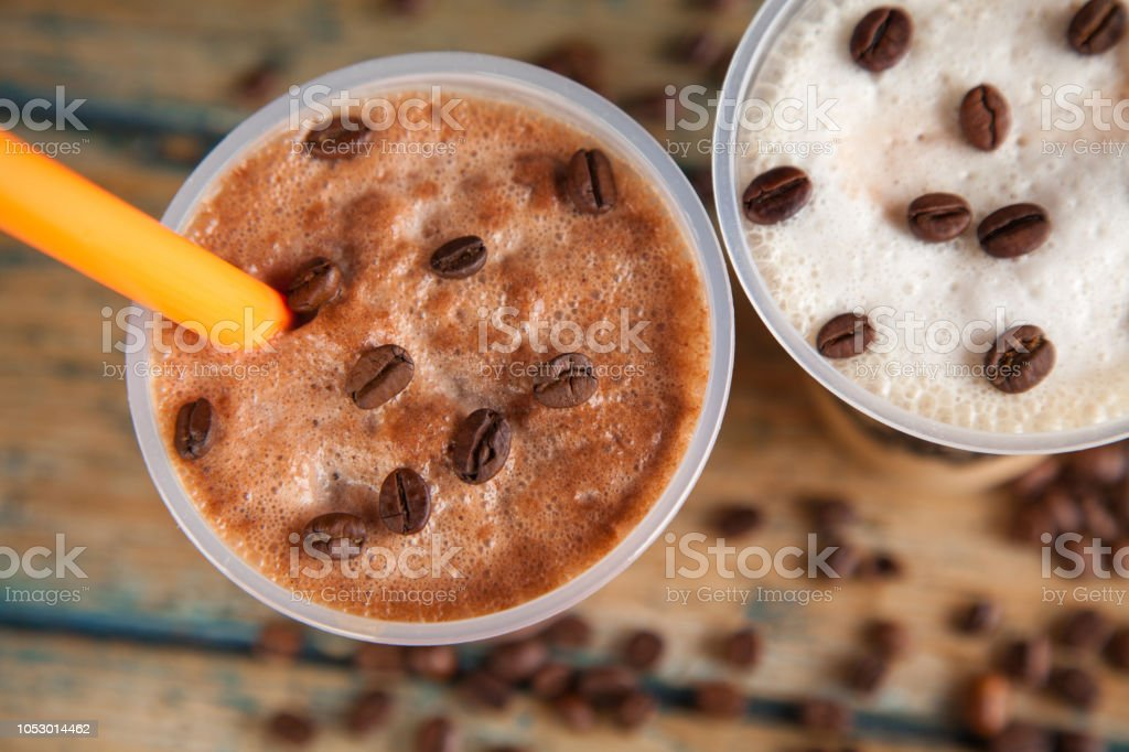 Iced frappes closeup with coffee beans stock photo
