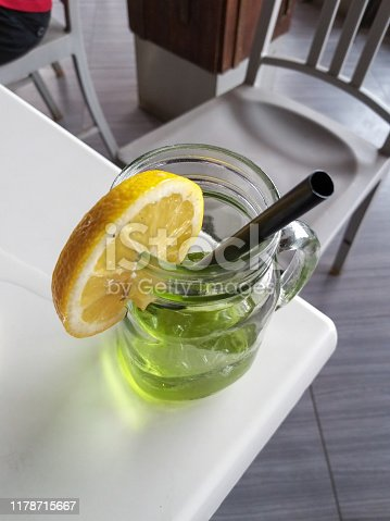 Top view of green tea ice with lemon slice on table of a cafe