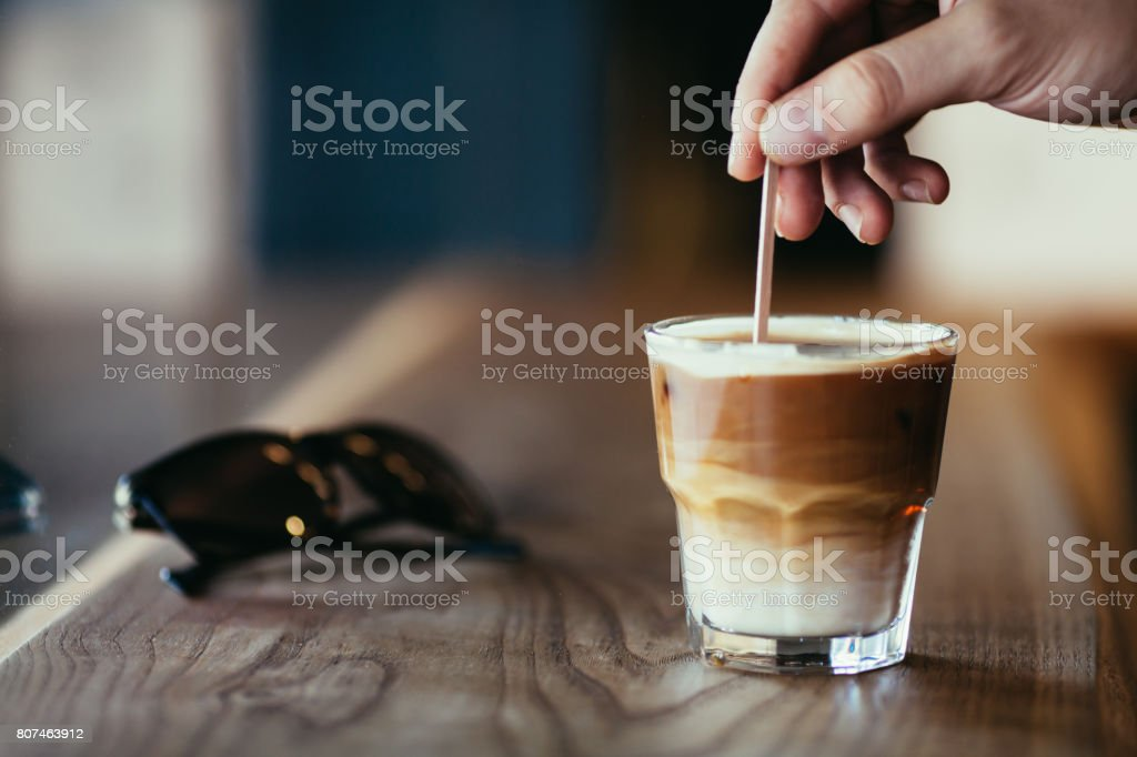 Iced latte on wooden counter stock photo
