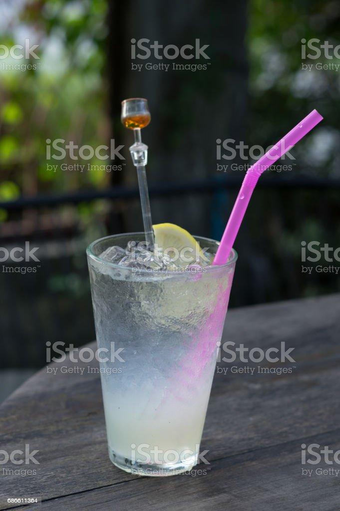 Iced Lemon juice glass on wood table. royalty-free stock photo