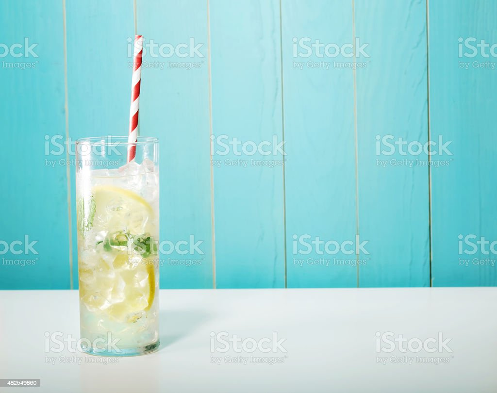 Iced lemonade with big red striped straws stock photo