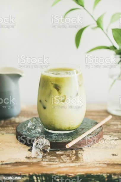 Iced matcha latte drink white wall at background vertical composition picture id1029899556?b=1&k=6&m=1029899556&s=612x612&h=k7scdmz4yba1hw1za6xplail0bja9kfgaj oi73bawi=