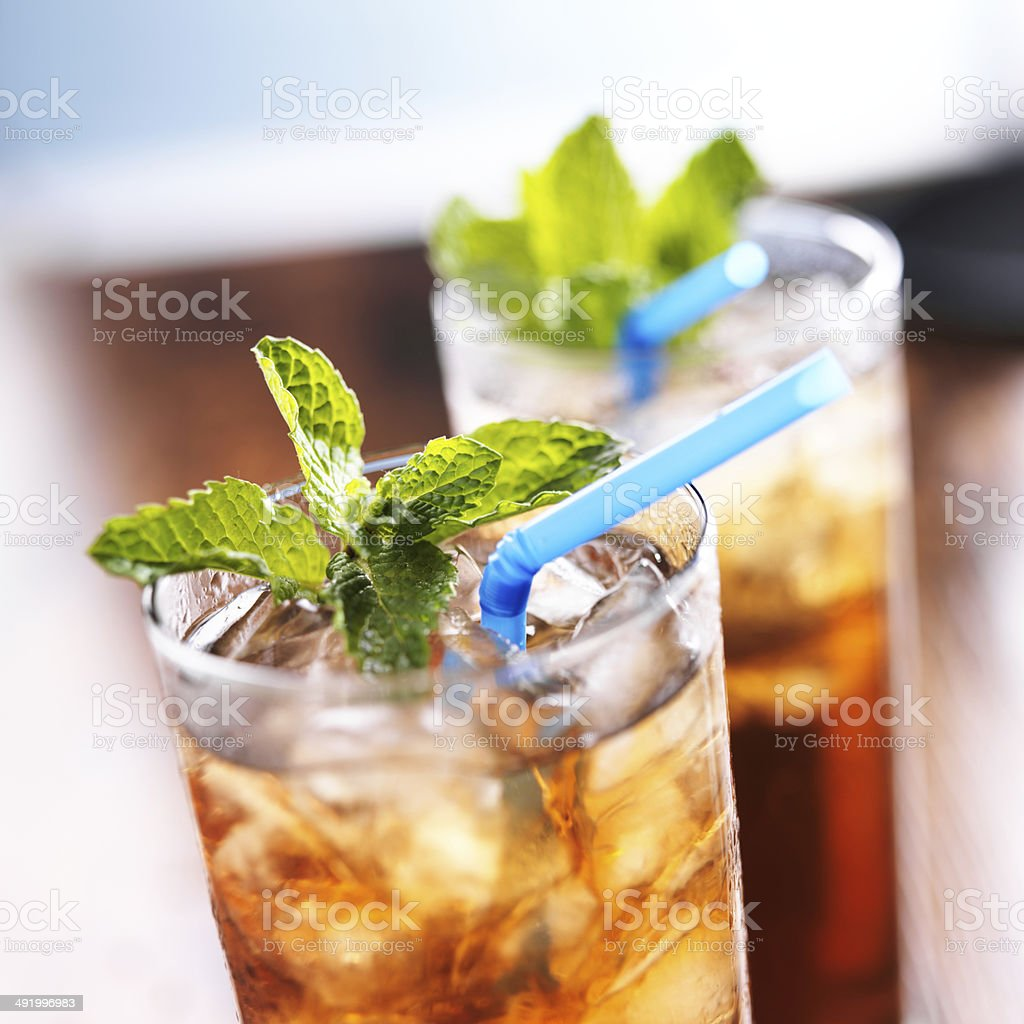 iced sweet tea close up with blue straw stock photo