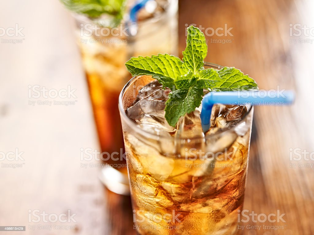 iced sweet tea with blue straw stock photo