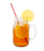 Iced tea in a jar with lemon slice isolated on white