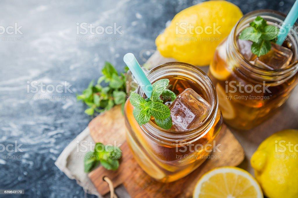 Iced tea in glass jars stock photo