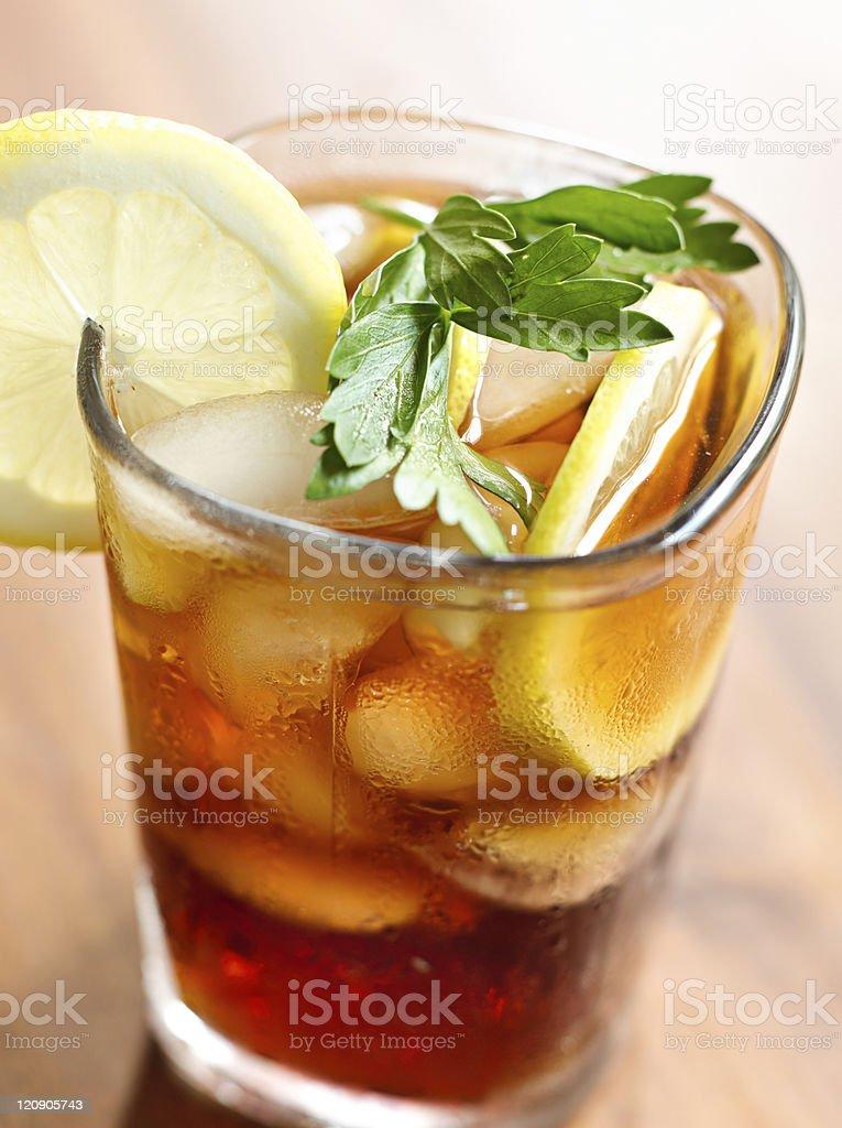 iced tea with lemon slice and leaf garnish. royalty-free stock photo