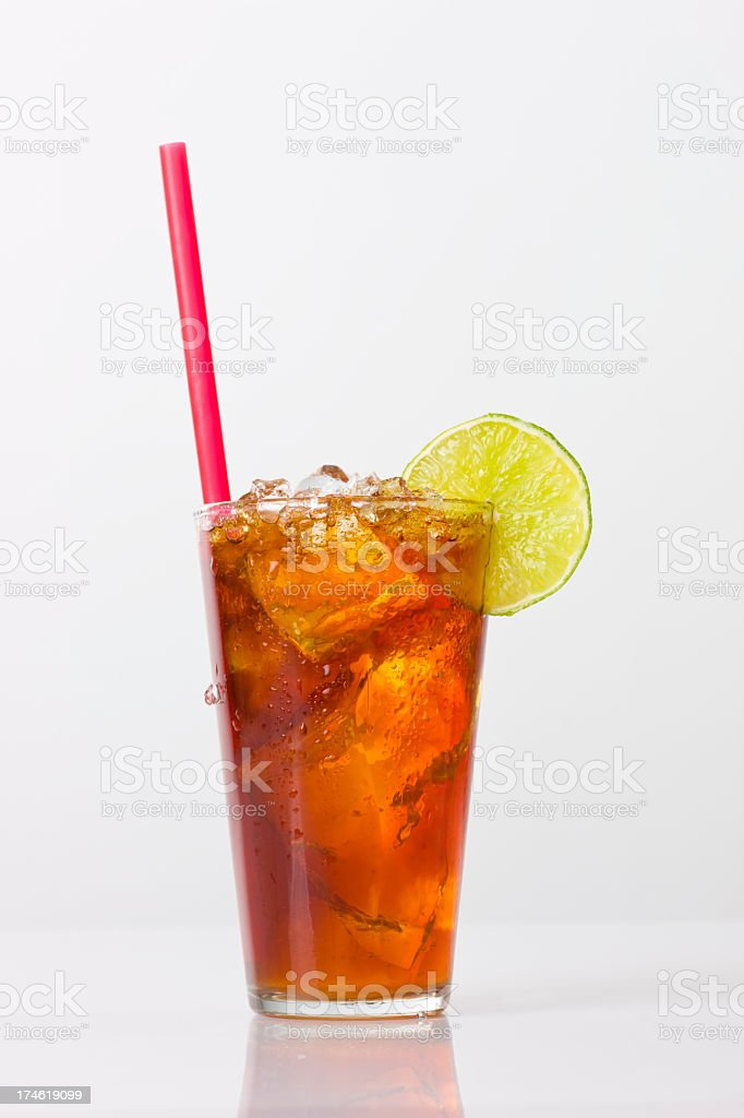 Iced tea with lime isolated on a white background stock photo