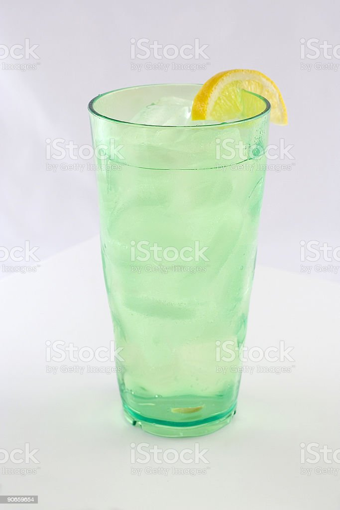 Iced Water With Lemon in Green Glass royalty-free stock photo
