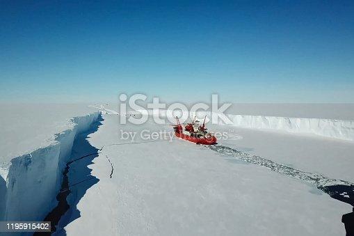 istock Ice-enpalled naldo, ice breaking ship. 1195915402