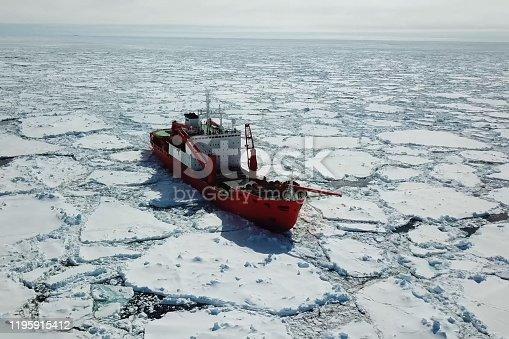 istock Ice-enpalled naldo, ice breaking ship. 1195915412