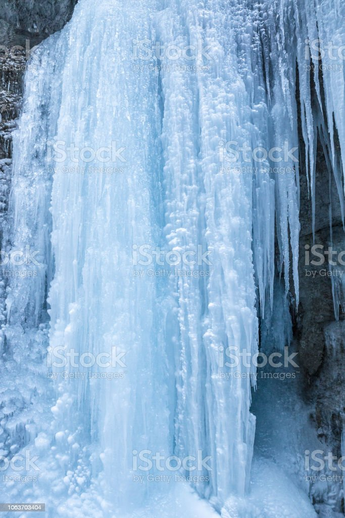 icefall on a rock wall stock photo