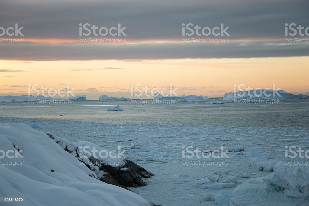 Icefjord with icebergs seen from the coast stock photo