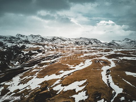 Iceland aerial view Landscape with snow and clouds, street and yellow and green grass. Photo taken in Iceland.