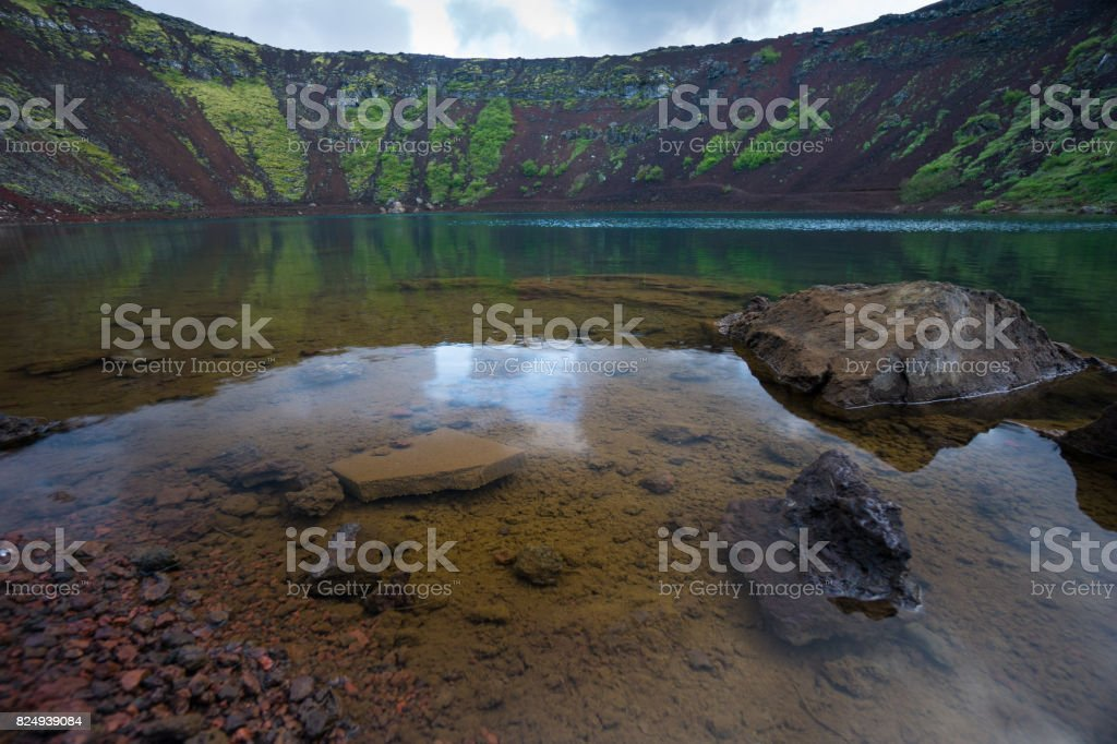Iceland - Clear blue water at Kerid Crater Lake stock photo