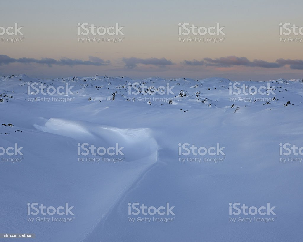 Iceland, fresh snow drifts over lava field foto de stock royalty-free
