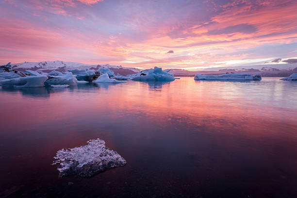 Iceland, Jokulsarlon Glacier Lagoon at sunset Iceland, stunning sunset at Jokulsarlon Glacier Lagoon at sunset. Icebergs floating on cold water glacier lagoon stock pictures, royalty-free photos & images