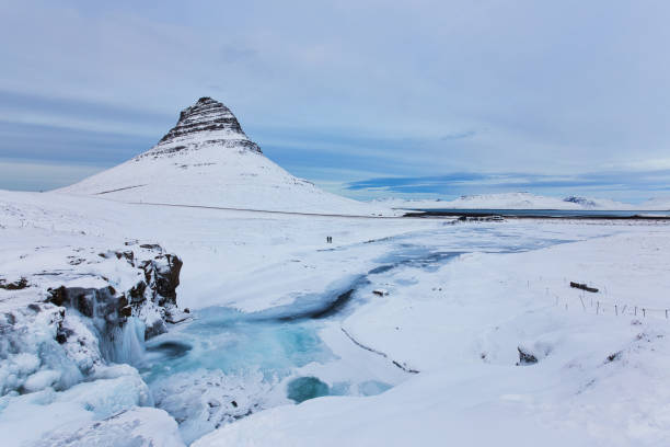 Iceland Landscape Winter Panorama, Kirkjufell Mountain Covered by Snow with Waterfall stock photo