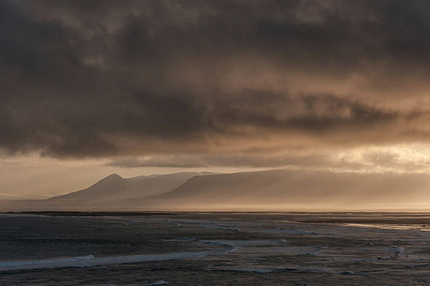 Iceland Landscape with Ocean Water and Clouds in Background stock photo