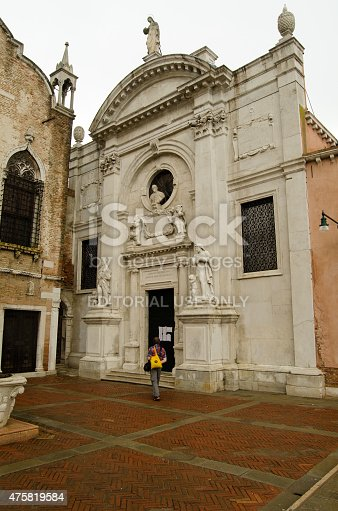Venice, Italy - May 26, 2015:  A visitor approaches the closed door to the Iceland Pavilion at the Venice Biennale art festival.  The exhibit by Christoph Buchel involved creating a mosque inside the Santa Maria dell'Abbazia della Misericordia church.  Controversy has led authorities to close the building.