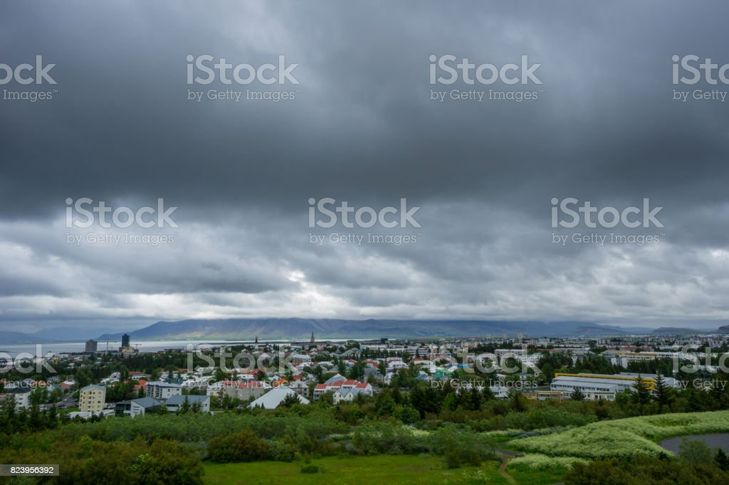 Iceland - Reykjavik City from above with dark clouds stock photo