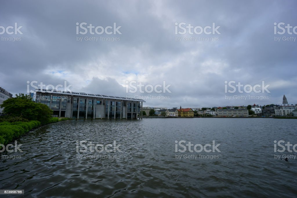 Iceland - Reykjavik townhall and houses with water stock photo