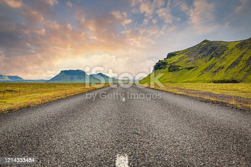 Open Iceland Ring Road or Route 1 under colorful twilight skyscape. The famous Iceland Ring Road is about 828 miles long - 1332 kilometres, making it the longest road in Iceland. Nordic Countries, Southern Iceland, Iceland, Europe