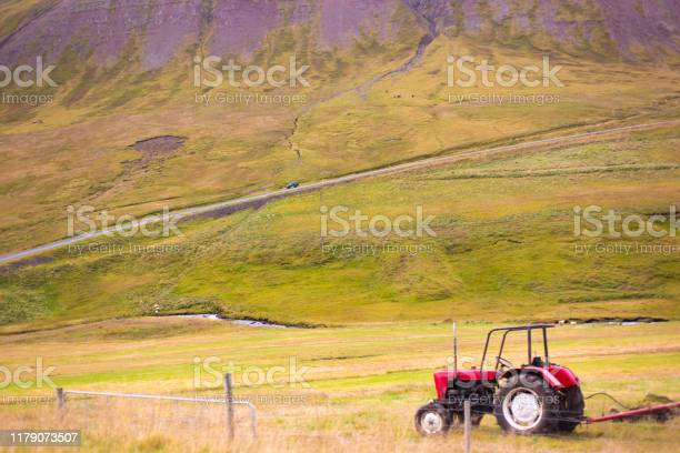 Iceland: Vintage Red Tractor in Beautiful Landscape, Close-Up