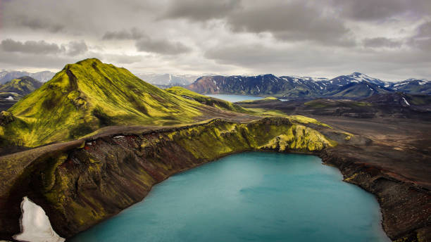 Iceland volcanic landscape intense colors rhyolith mountains volcano crater lake stock photo