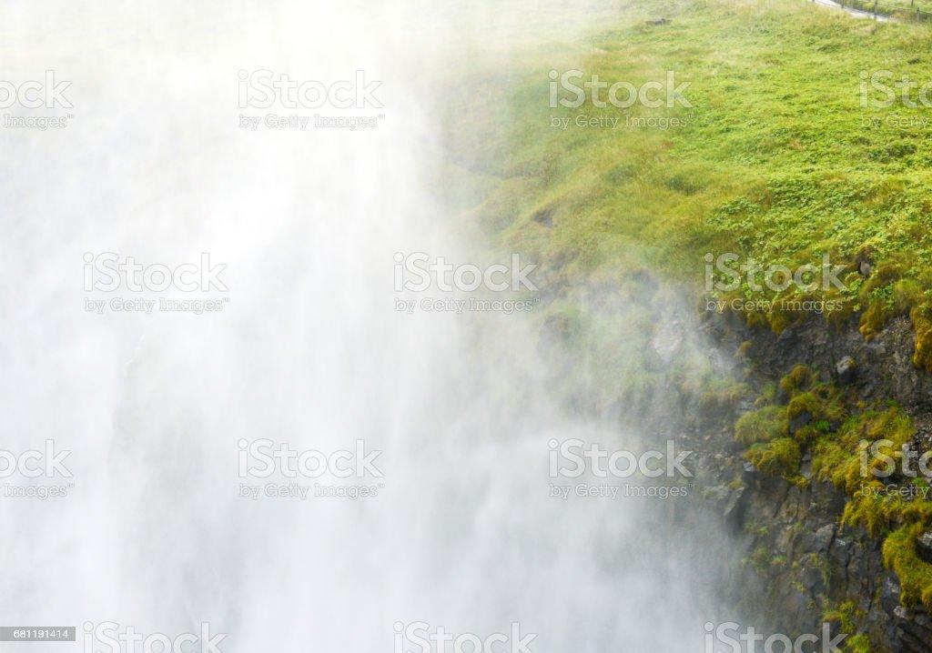 Iceland waterfall spraying royalty-free stock photo