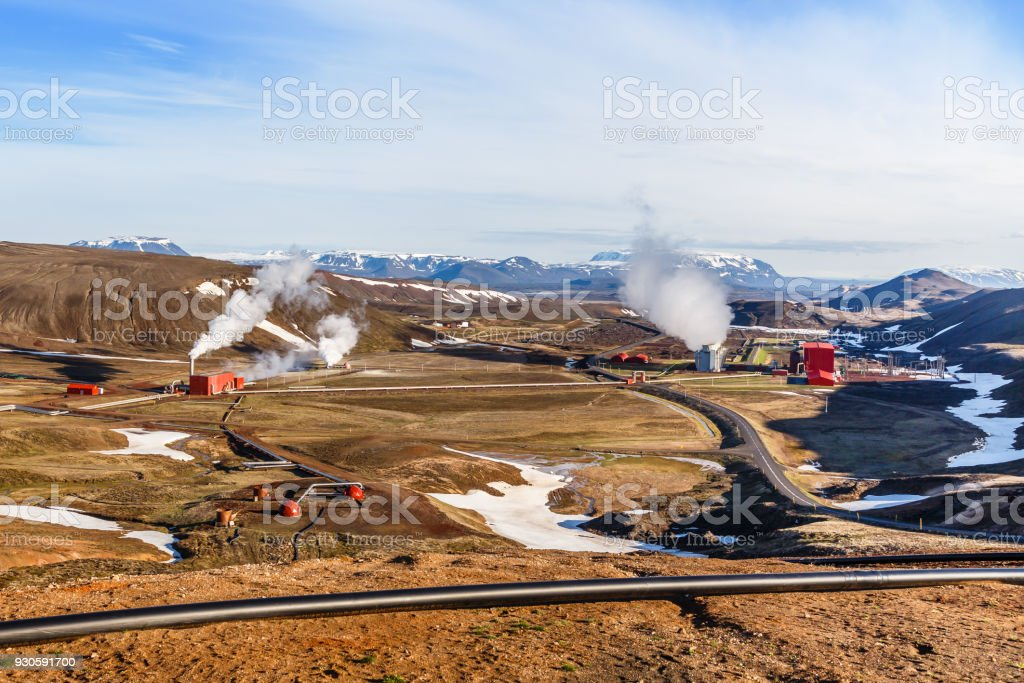 Icelandic landscape with geothermal power plant station and pipes in the valley, Myvatn lake surroundings, Iceland stock photo