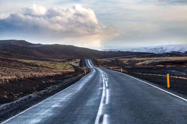 icelandic road through the lava fields, iceland stock photo