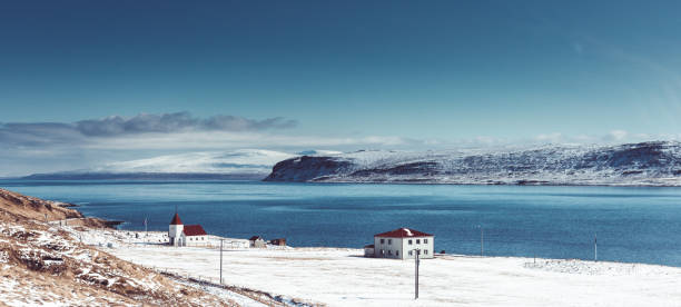 icelandic village with fjord in the background stock photo