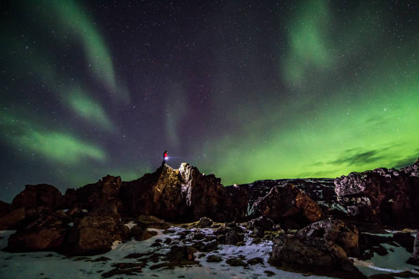 Icelandic winter landscape with northern lights stock photo