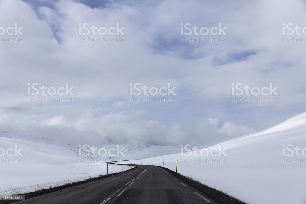 Iceland's Circle Road winds through snow covered hills royalty-free stock photo