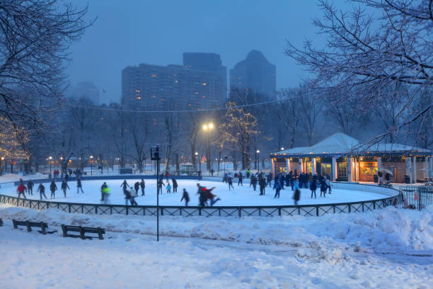 Ice-skating on Frog Pond in the Boston Common stock photo