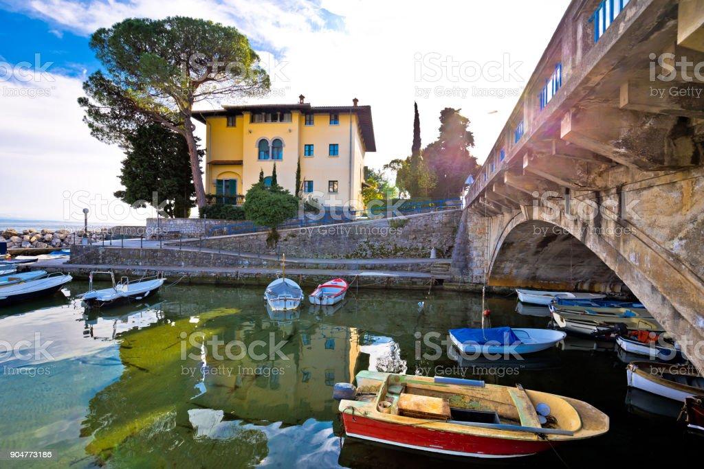 Icici village bridge and harbor in Opatija riviera view, turquoise sea and blue sky, Kvarner, Croatia stock photo