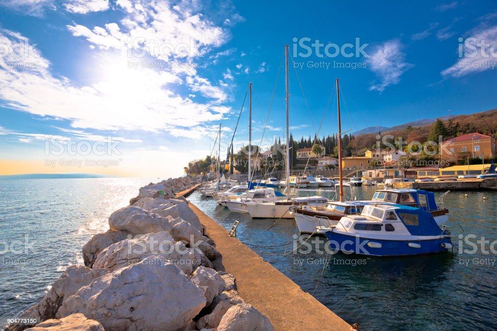 Icici village waterfront and harbor in Opatija riviera, turquoise sea and blue sky, Kvarner, Croatia stock photo