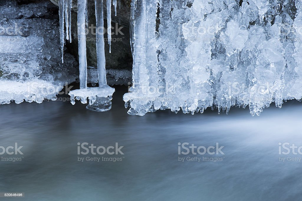 Icicle of beautiful frozen waterfall in the winter season stock photo