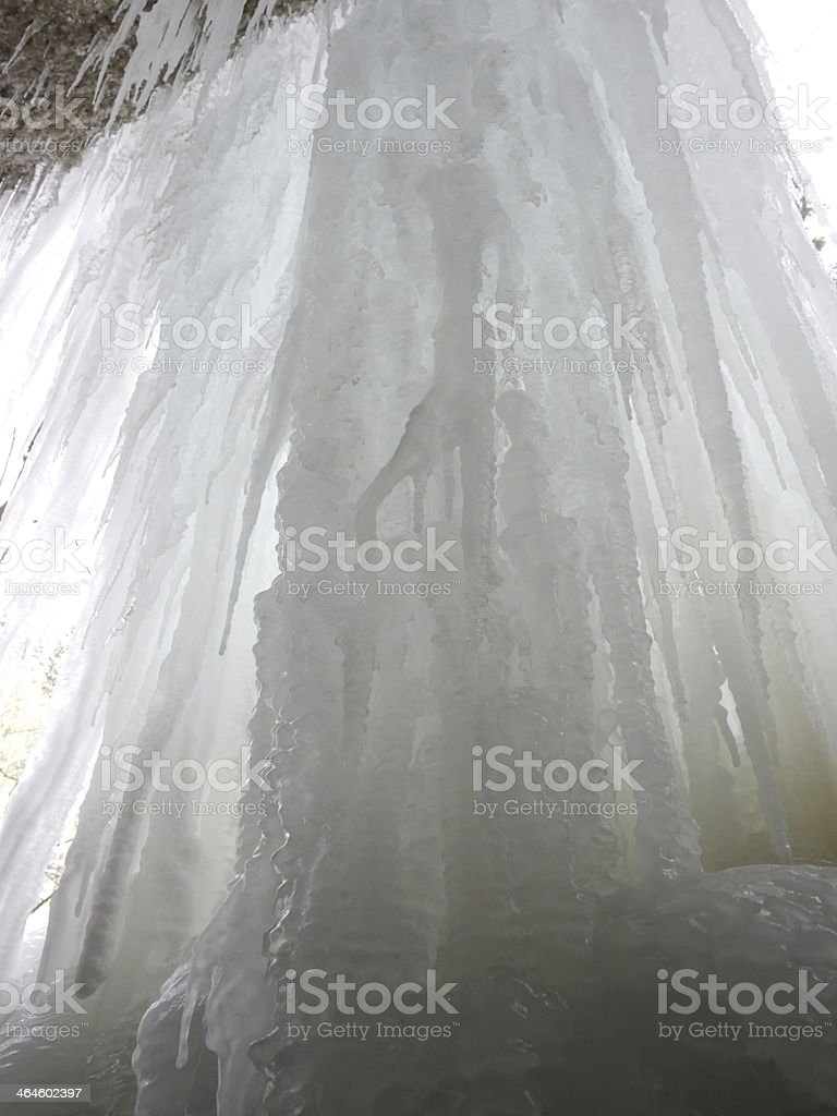 icicles above the frozen river stock photo