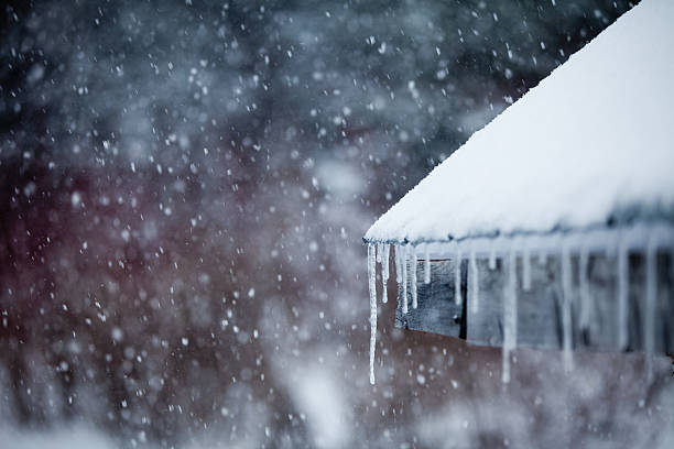 icicles and snowstorm - weather stock photos and pictures