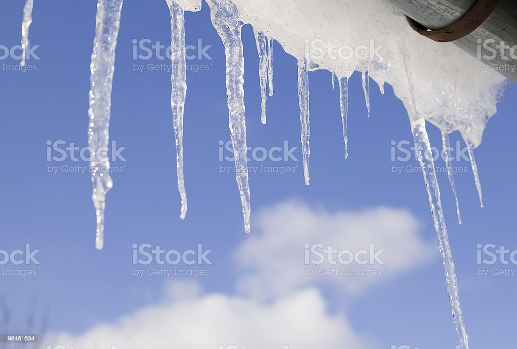 Icicles frame on cloudy sky background royalty-free stock photo