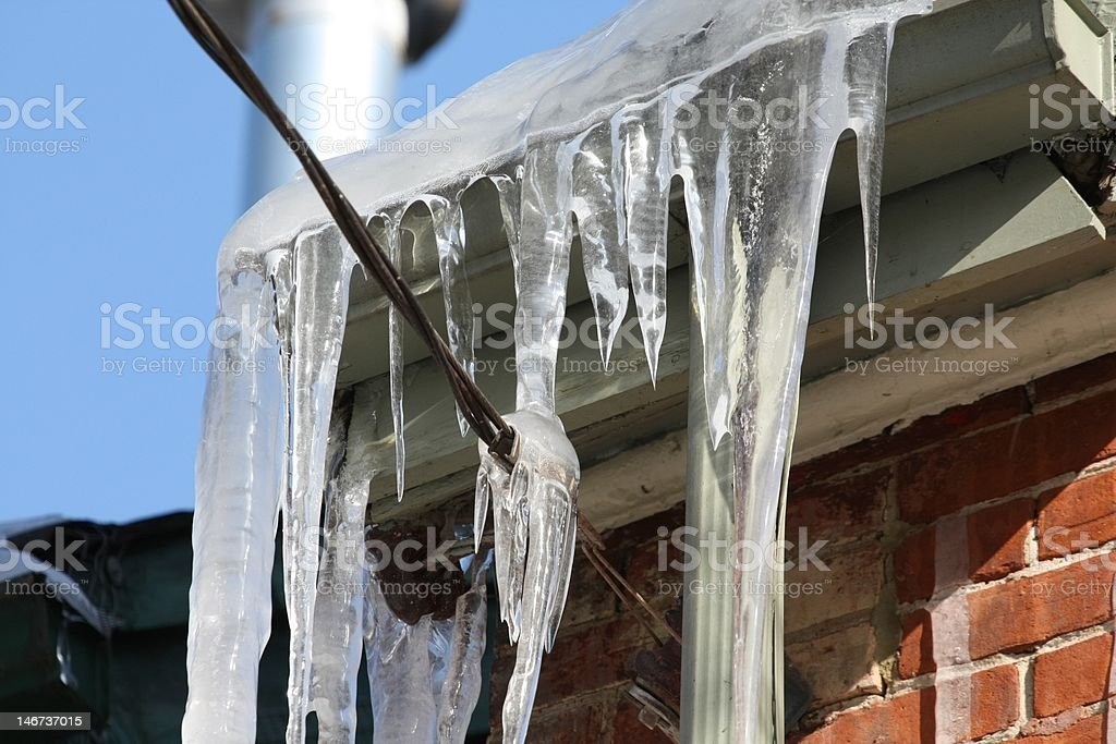 Icicles hanging from eaves stock photo