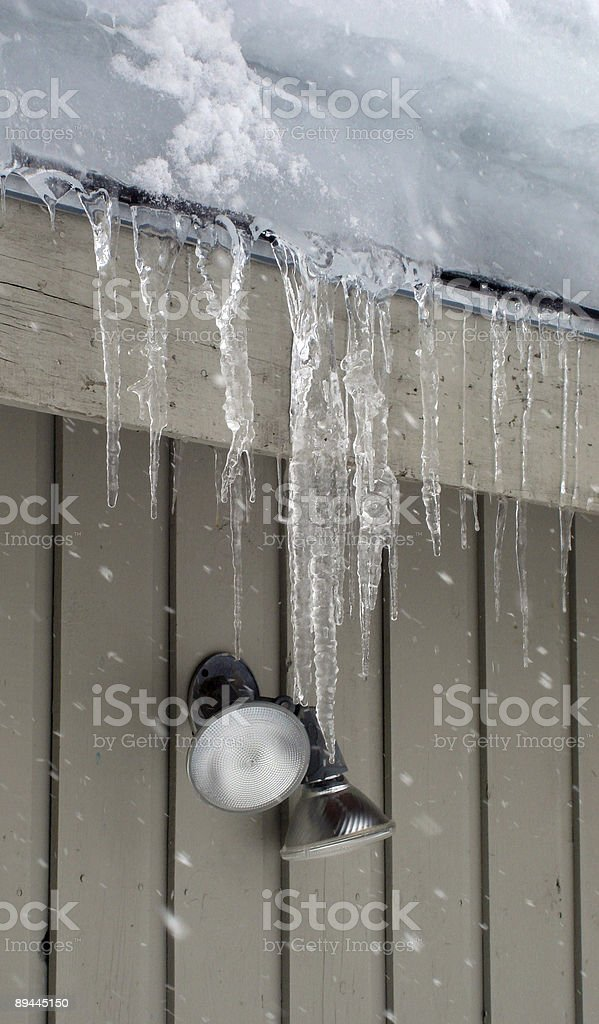 icicles hanging from roof royalty-free stock photo