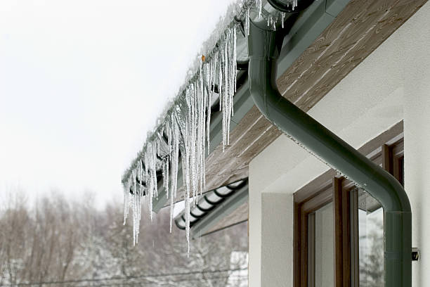 icicles hanging from the roof of a house - icicle bildbanksfoton och bilder