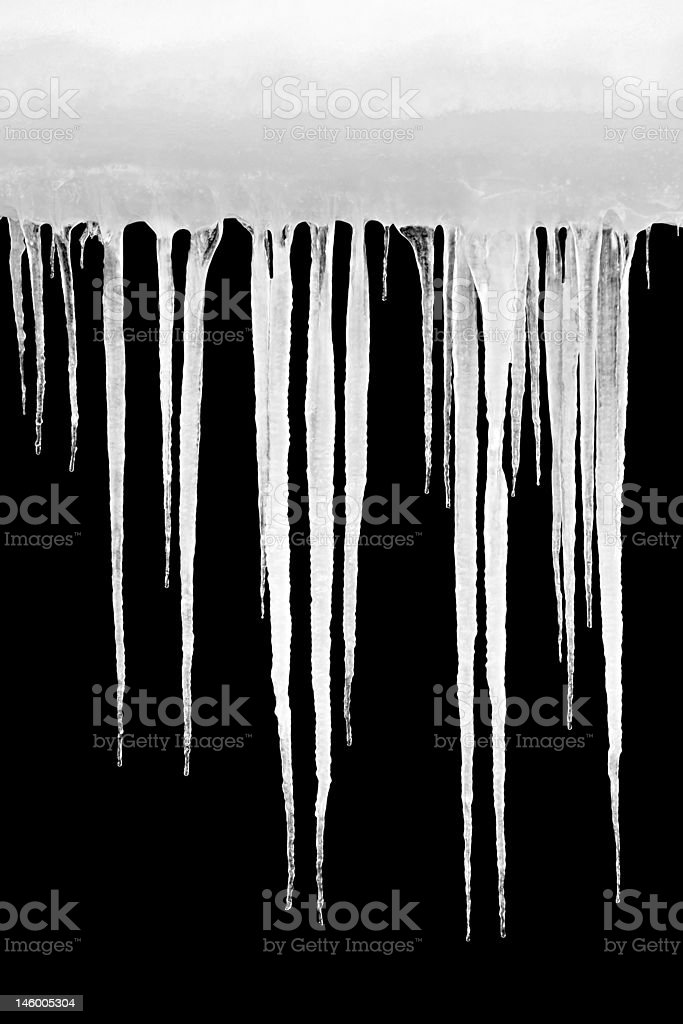 icicles isolated on black stock photo
