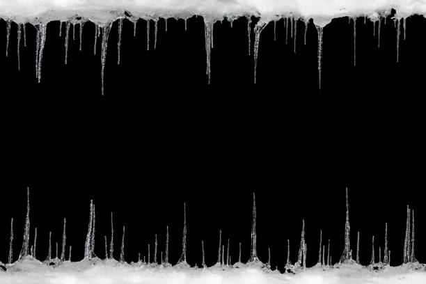 Icicles on a black background, space for text, template for design stock photo