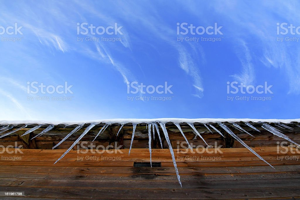 Icicles on a roof royalty-free stock photo